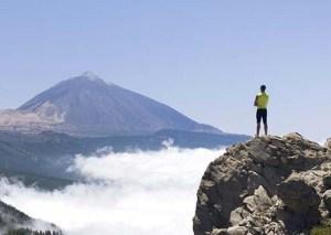 Man_on_a_mountain_peak_FAN2045462