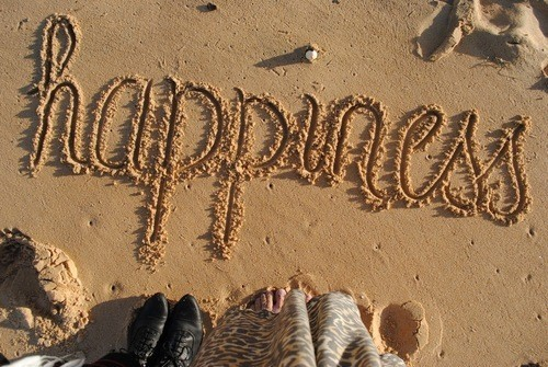 happiness written in sand